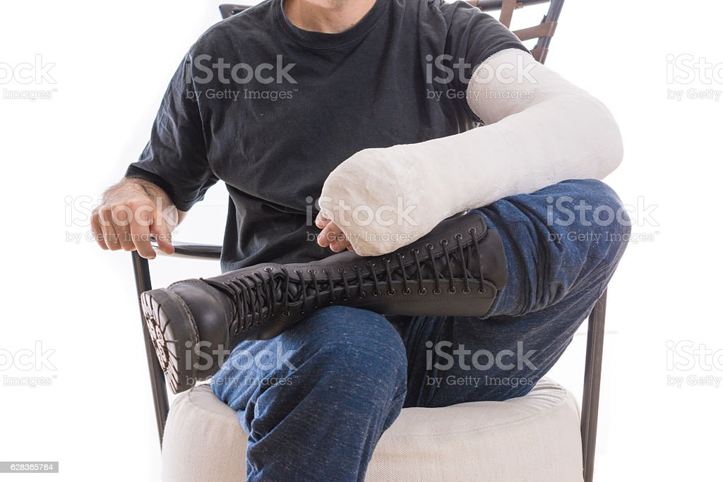 War and injury - cast and combat boot concept stock photo