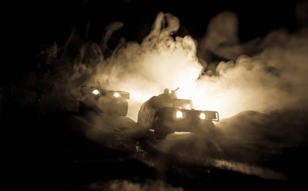 War Concept. Battle scene on war fog sky background, Fighting silhouettes Below Cloudy Skyline at night. – zdjęcie
