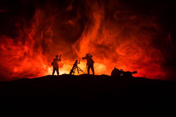 War Concept. Military silhouettes fighting scene on war fog sky background, – zdjęcie