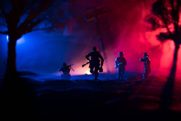 War Concept. Military silhouettes fighting scene on war fog sky background, World War Soldiers Silhouette Below Cloudy Skyline At night. – zdjęcie