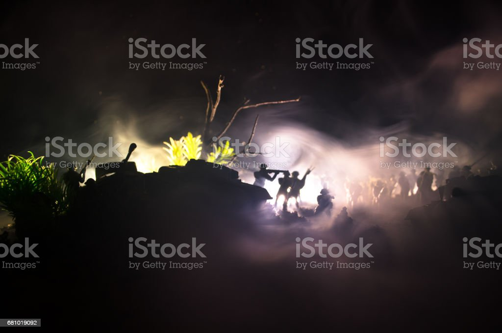 War Concept. Military silhouettes fighting scene on war fog sky background, World War Soldiers Silhouettes Below Cloudy Skyline At night. Attack scene. Armored vehicles. royalty-free stock photo