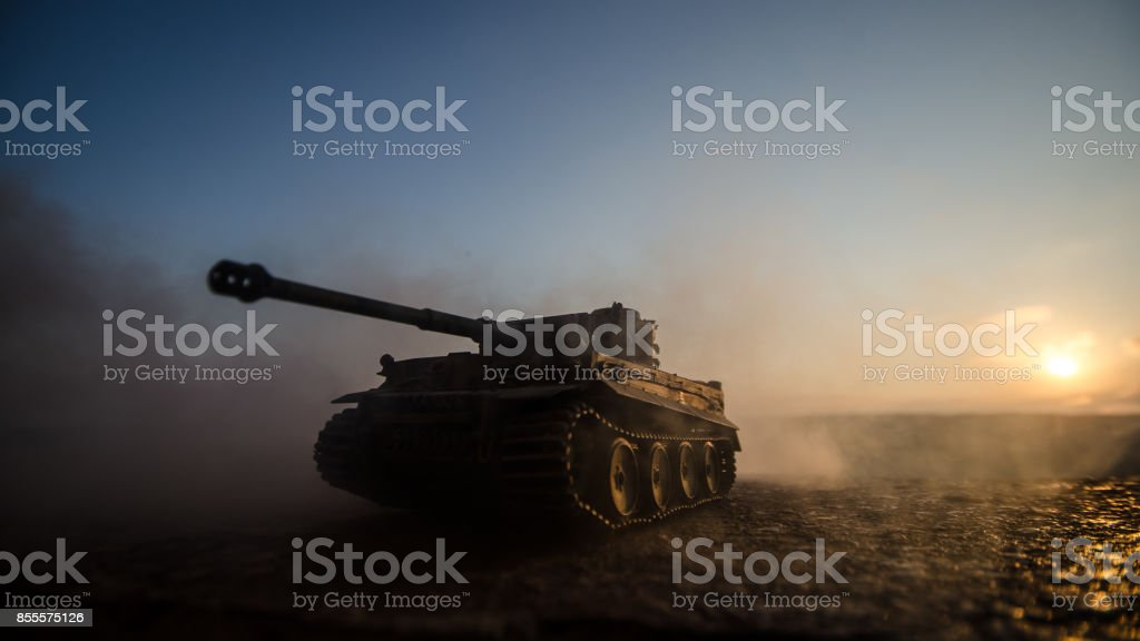 War Concept. Military silhouettes fighting scene on war fog sky background, World War Soldiers Silhouettes Below Cloudy Skyline at sunset. Armored vehicles. German tank in action stock photo