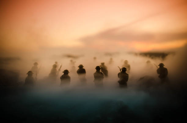 War Concept. Military silhouettes fighting scene on war fog sky background, World War Soldiers Silhouettes Below Cloudy Skyline At night. Attack scene. Armored vehicles. Tanks battle War Concept. Military silhouettes fighting scene on war fog sky background, World War Soldiers Silhouettes Below Cloudy Skyline At night. Attack scene. Armored vehicles. Tanks battle. Decoration battlefield stock pictures, royalty-free photos & images