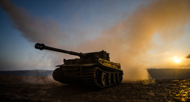 War Concept. Military silhouettes fighting scene on war fog sky background, World War Soldiers Silhouettes Below Cloudy Skyline at sunset. Armored vehicles. German tank in action – zdjęcie