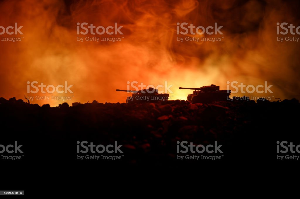 War Concept. Military silhouettes fighting scene on war fog sky background, World War German Tanks Silhouettes Below Cloudy Skyline At night. Attack scene. Armored vehicles. Tanks battle. Close up stock photo