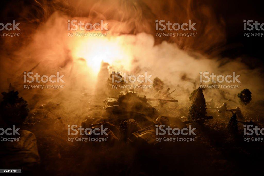 War Concept. Military silhouettes fighting scene on war fog sky background, World War Soldiers Silhouettes Below Cloudy Skyline At night. Attack scene. Selective focus Tanks battle. Decoration - Zbiór zdjęć royalty-free (Amunicja)