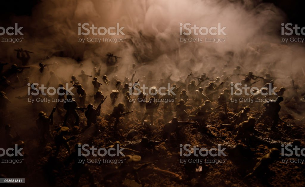 War Concept. Military silhouettes fighting scene on war fog sky background, World War Soldiers Silhouettes Below Cloudy Skyline At night. Attack scene. Selective focus Tanks battle. Decoration stock photo