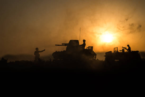 War Concept. Military silhouettes fighting scene. World War German Tanks and soldiers silhouettes at sunset. Attack scene. Armored vehicles. War Concept. Military silhouettes fighting scene. World War German Tanks and soldiers silhouettes at sunset. Attack scene. Armored vehicles. Tanks battle battlefield stock pictures, royalty-free photos & images