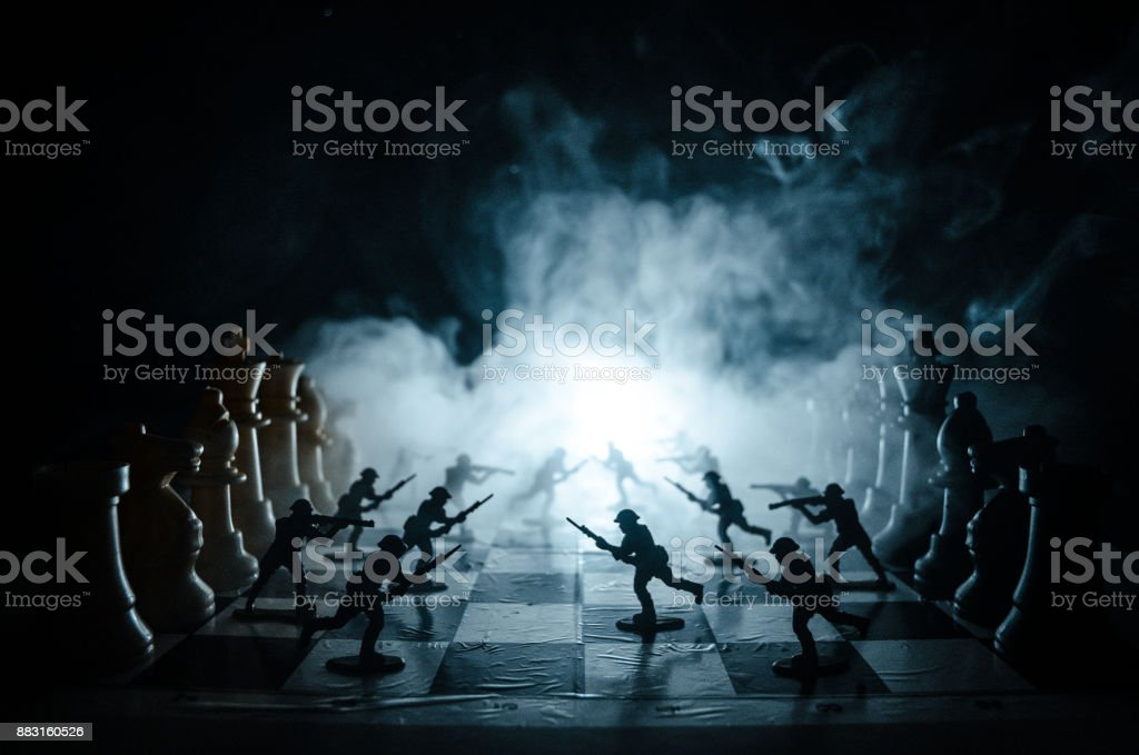 War Concept Silhouettes Of Soldiers On Chessboard War Concept