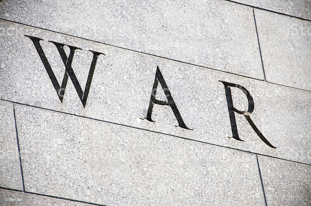 'War' Cut In Stone royalty-free stock photo