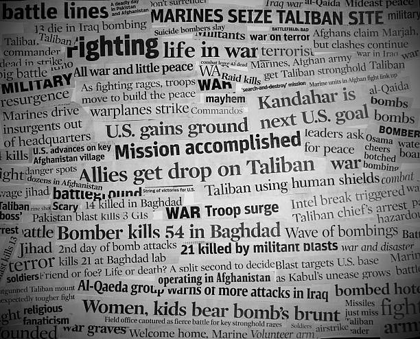war headlines black and white with vignette stock photo