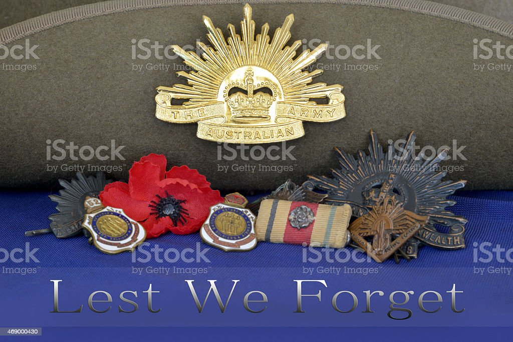 war medals resting on slouch hat and lest we forget stock photo