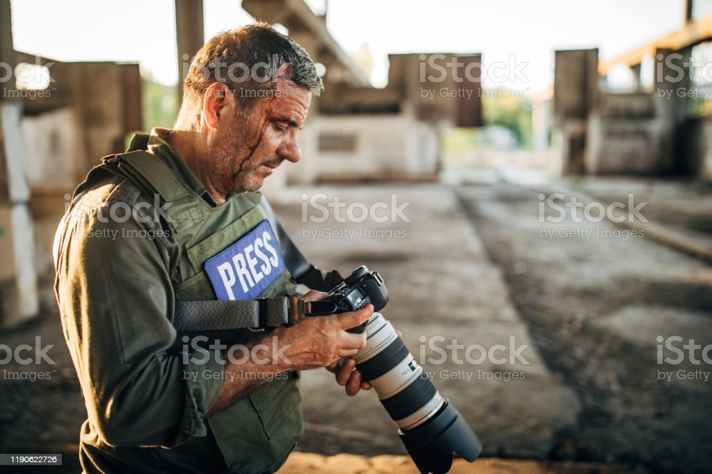War Photographer In Abandoned Building Stock Photo Download Image Now Istock