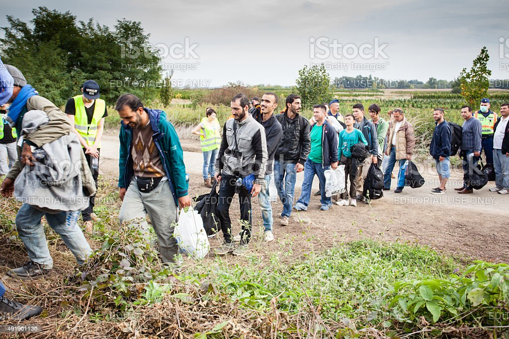 War refugees at Zakany Railway Station Zakany, Hungary - October 6, 2015: War refugees at Zakany Railway Station, Refugees are arriving constantly to Hungary on the way to Germany. 6 Octoberber 2015 in Zakany, Hungary. 2015 Stock Photo