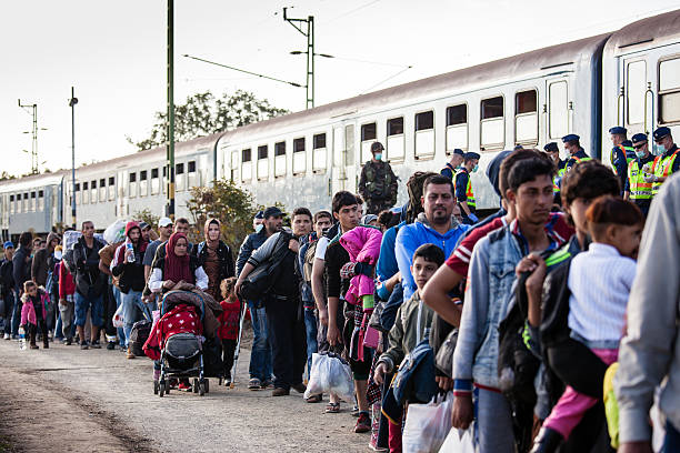 war refugees at zakany railway station - 2015 stock pictures, royalty-free photos & images