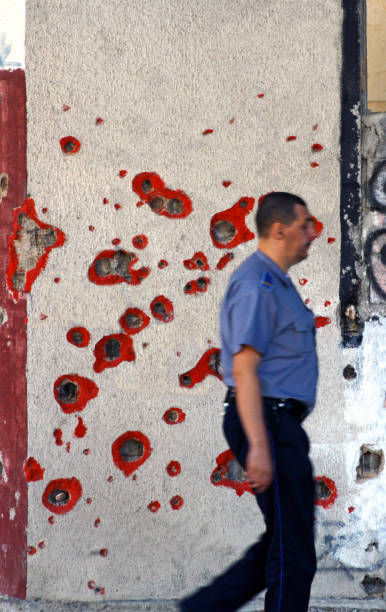 War scars: Shrapnel and bullet holes in a wall in Sarajevo, Bosnia and Herzegovina stock photo