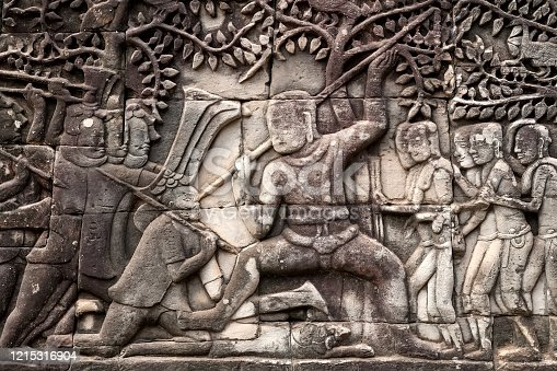 1147569123 istock photo War scene on 12th century relief of Bayon temple, Cambodia. Historical artwork on wall of Khmer landmark in Angkor. UNESCO world heritage site 1215316904