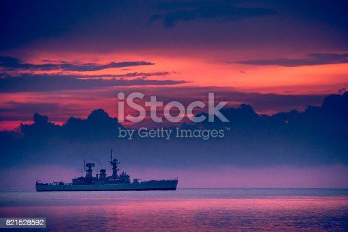 istock war ship sunset, Beautiful sunset on the beach, Sunset lake landscape 821528592
