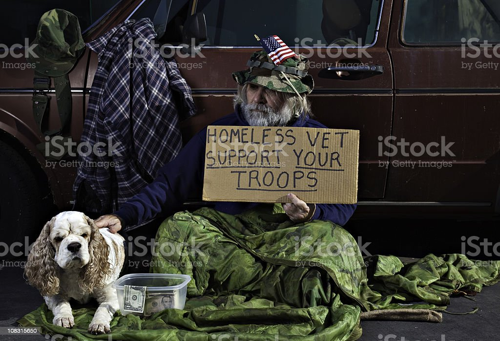 War Veteran and His Dog  Adult Stock Photo