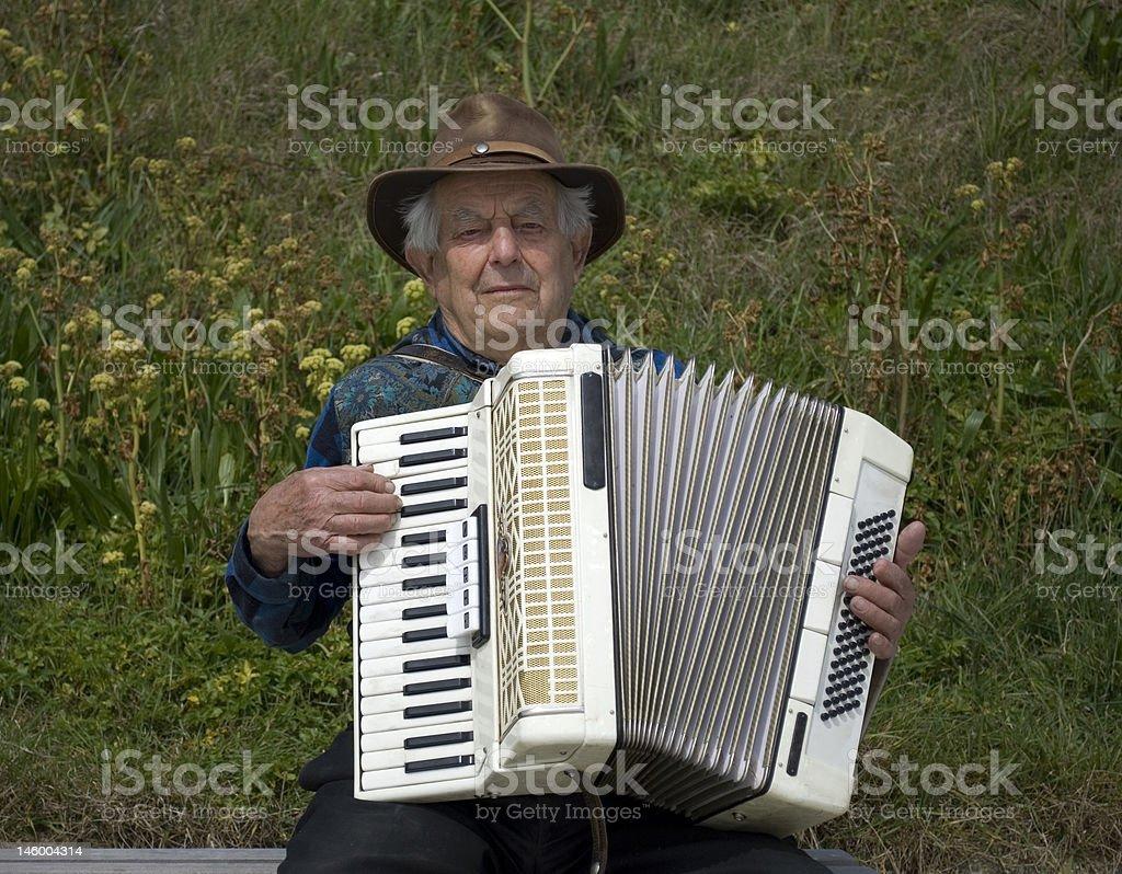War veteran playing accordion royalty-free stock photo
