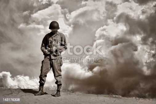 istock War Weary WWII Soldier During A Retrospective Moment 143176308