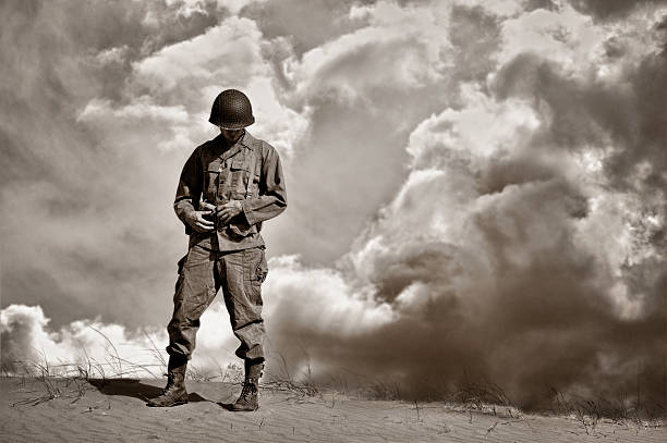 war weary wwii soldier during a retrospective moment - world war ii stock photos and pictures