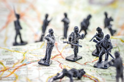 istock War with little soldier toy on map concept 539246741
