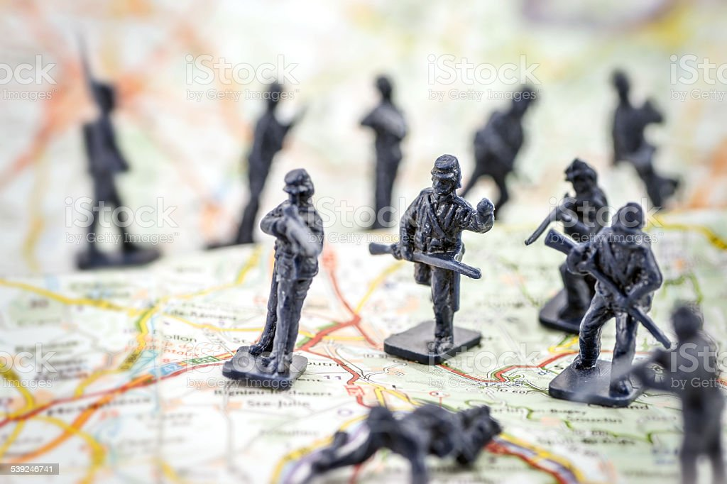 War with little soldier toy on map concept stock photo