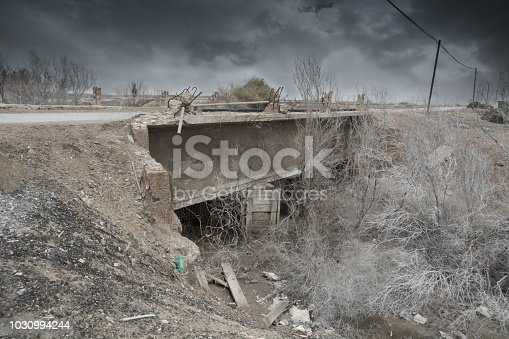 695022520 istock photo War zone, Destroyed Bridge, ruined infrastructure 1030994244