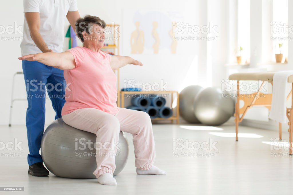 Ward sitting on fit ball stock photo