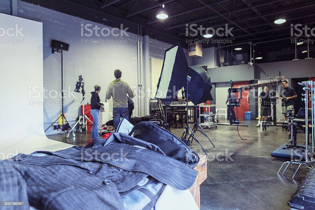 Wardrobe with Busy Film Set in Background stock photo