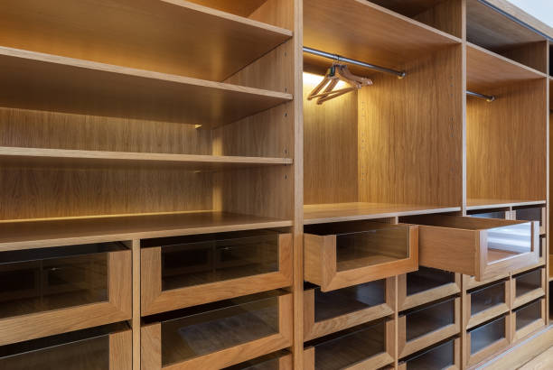 Wardrobe with empty drawers and shelves. stock photo