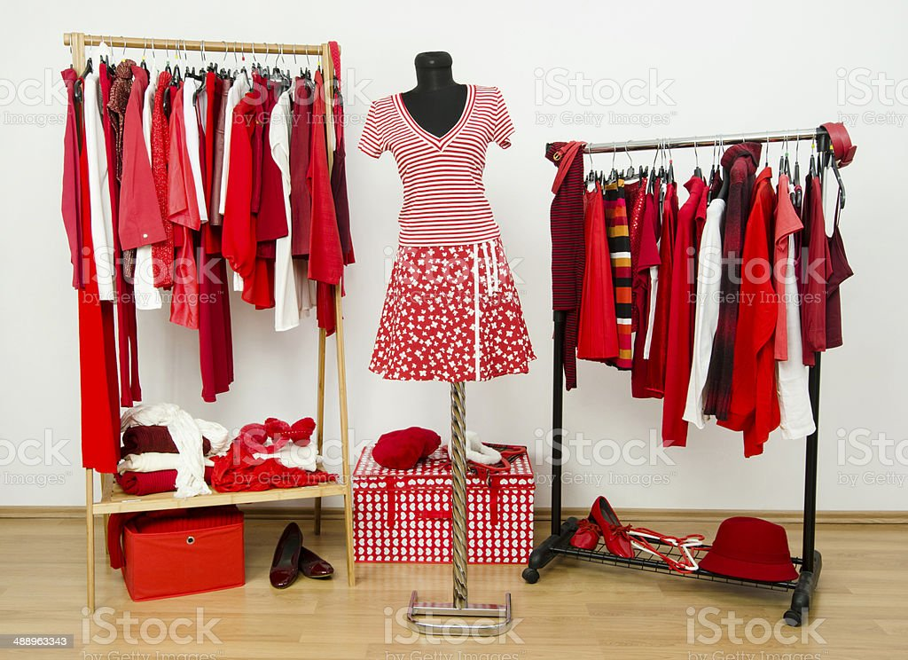 Wardrobe with red and white clothes, shoes, accessories. stock photo