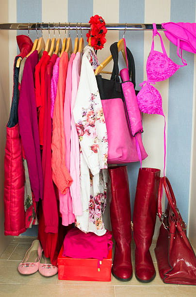 Wardrobe with red clothes on hangers stock photo