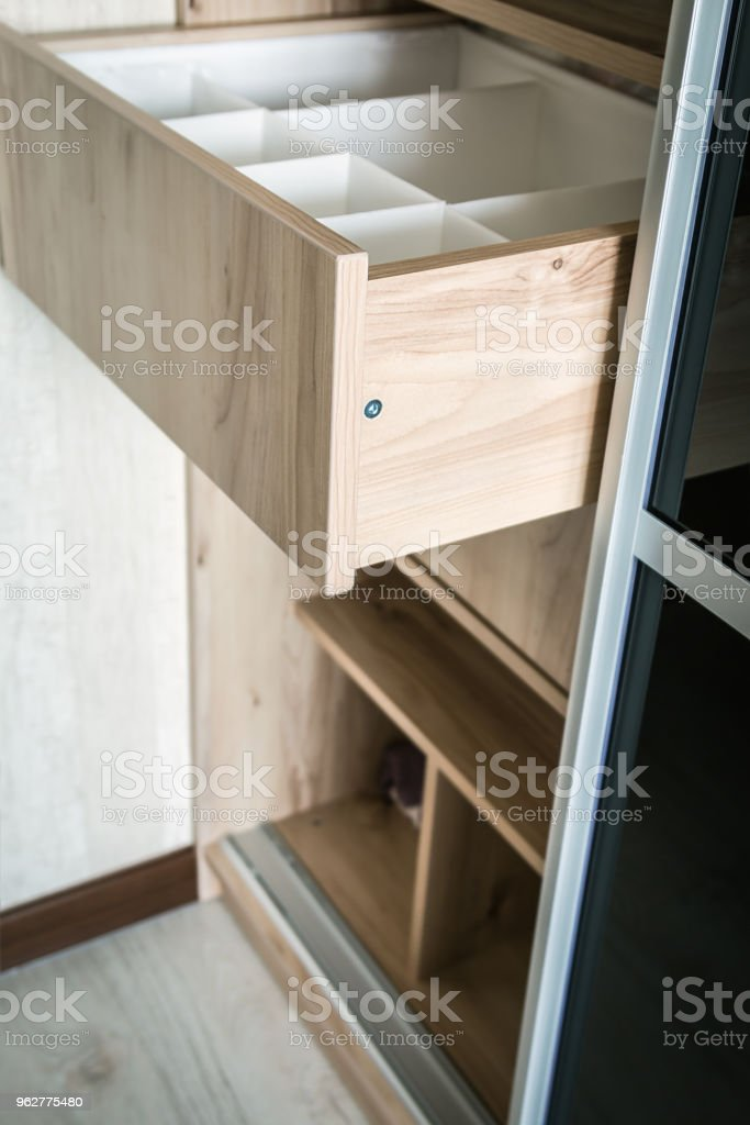 Wardrobe with sliding doors and drawers drawer - Foto stock royalty-free di Abbigliamento
