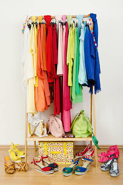 Wardrobe with summer clothes nicely arranged. stock photo