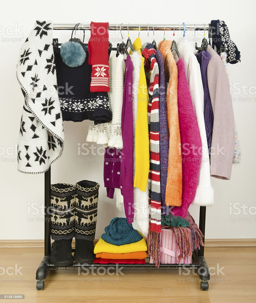 Wardrobe with winter clothes nicely arranged. stock photo