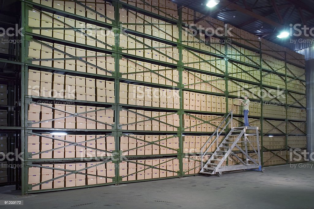 Warehouse almost completely filled with cardboard boxes royalty-free stock photo