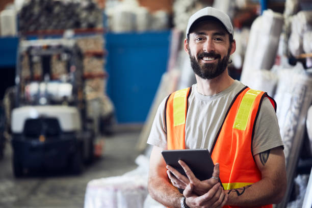 Warehouse and industry concept in Australia, working in small business. small business concept reflective clothing stock pictures, royalty-free photos & images