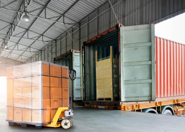 warehouse and logistics, freight transportation - caricare attività foto e immagini stock
