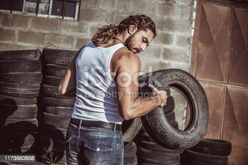 498879174 istock photo Warehouse automobile tires 1173660858