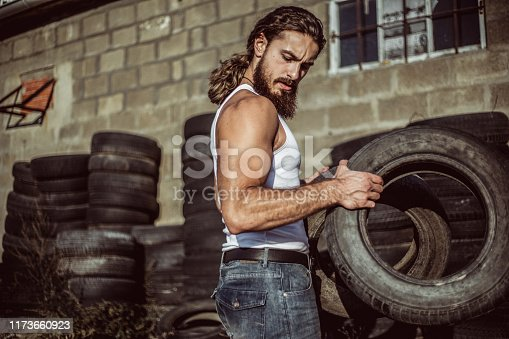 498879174 istock photo Warehouse automobile tires 1173660923