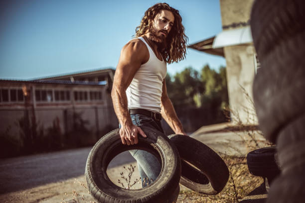 Warehouse automobile tires Mechanic, Tire - Vehicle Part, Auto Mechanic, Warehouse, Wheel long hair stock pictures, royalty-free photos & images