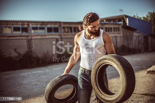 498879174 istock photo Warehouse automobile tires 1173661160