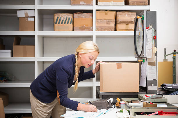 warehouse clerk checking a parcel stock photo