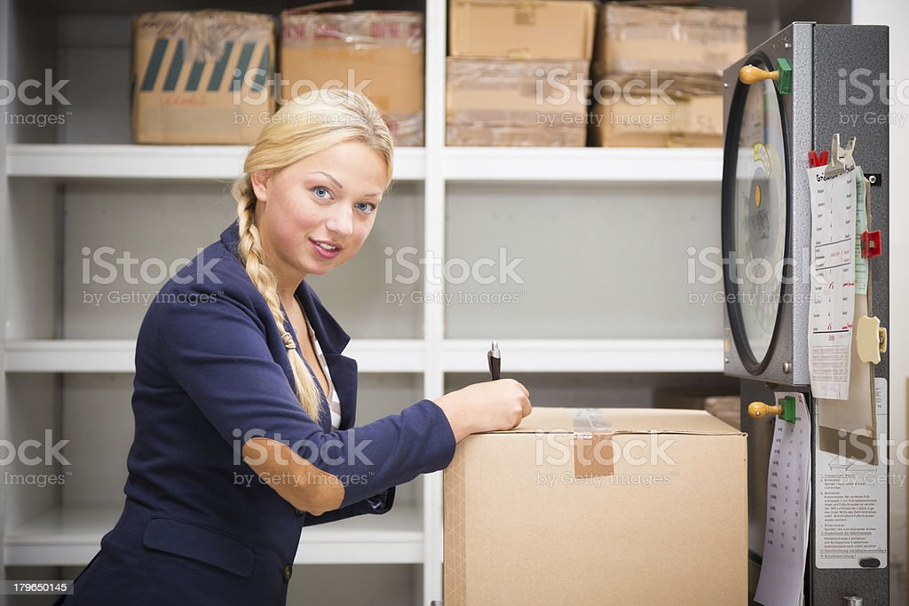 warehouse clerk checking a parcel royalty-free stock photo