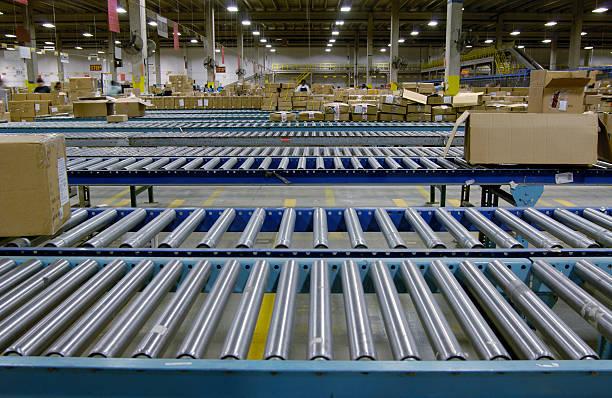 warehouse conveyor - conveyor belt stock photos and pictures