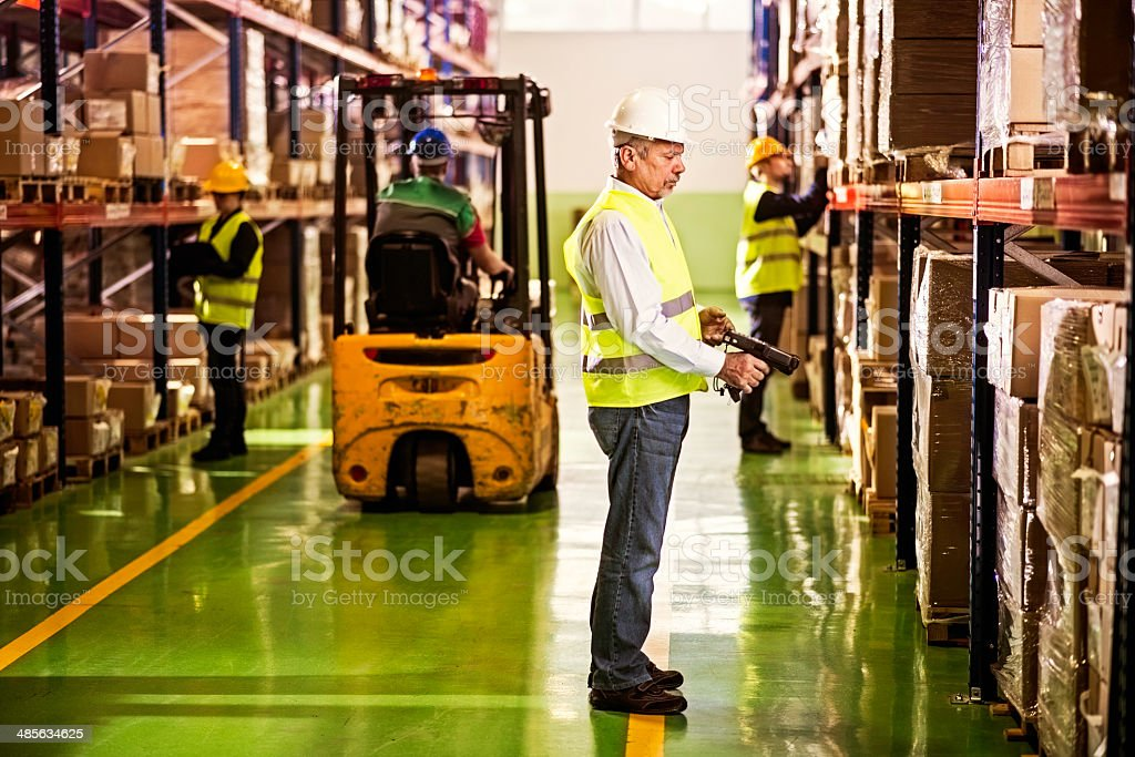 Warehouse Employee Scanning Boxes stock photo