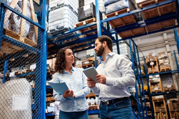 Warehouse employees taking inventory stock photo