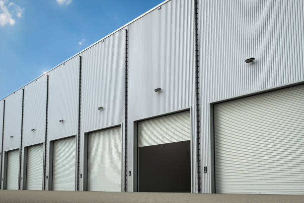 warehouse exterior with shutter doors - open gate stock photos and pictures
